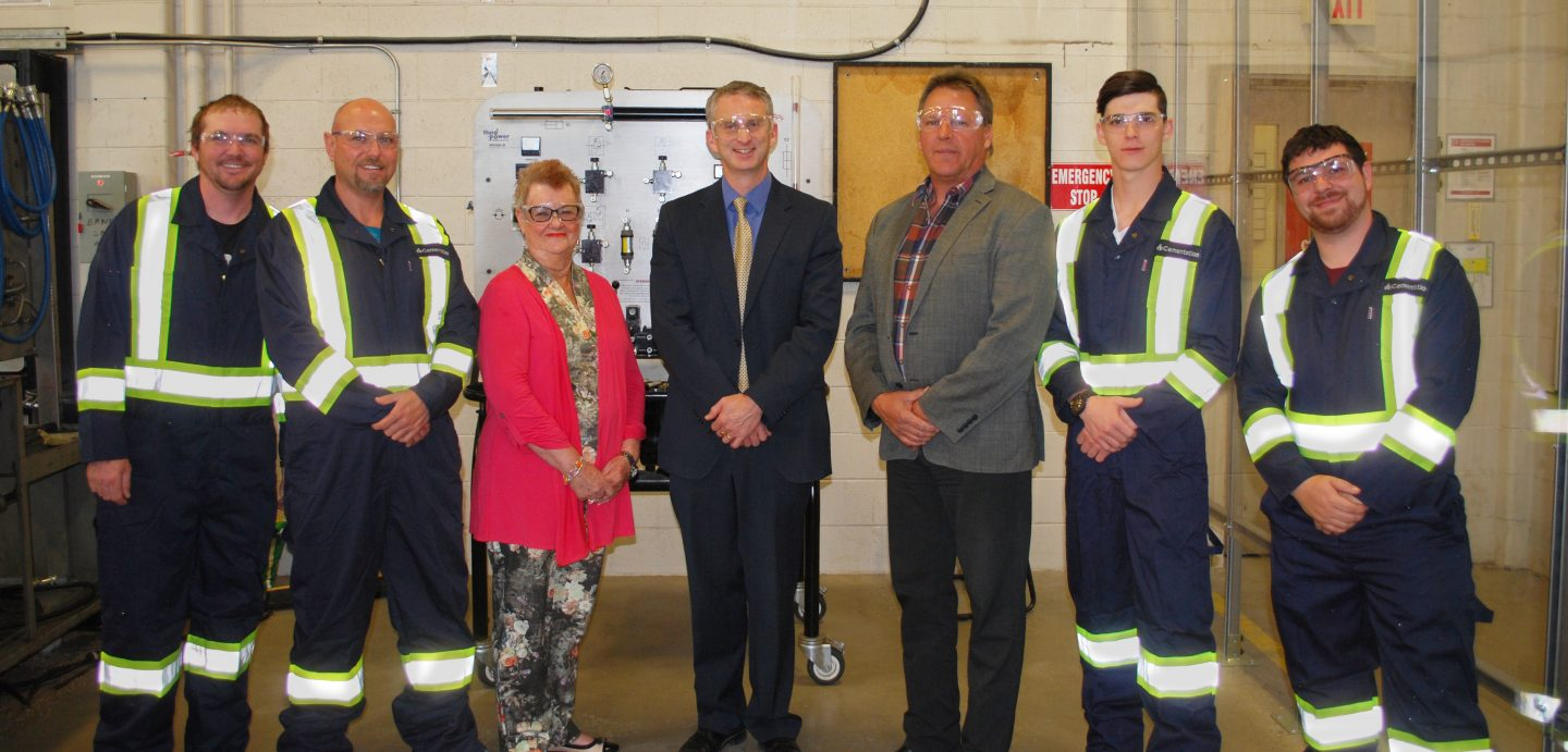 Pictured are (L-R): Cambrian College students Clinton Misener and Mike Boyle, Foundation Director Darlene Palmer, President Bill Best, Cementation Canada VP Operations Eric Kohtakangas; students Austin Sherwin and Chris Boisvenue.