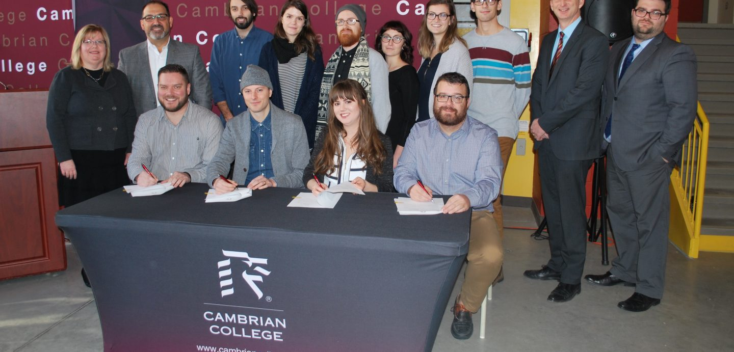 Photo - Students, business respresentatives, Cambrian staff and government officials gathered to formalize a partnership that will create learning opportunities for graphic design students.