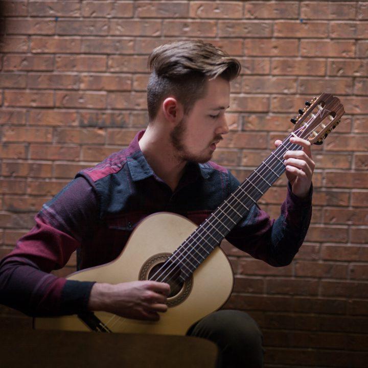 Guitar student Nikolas Landry plating guitar.