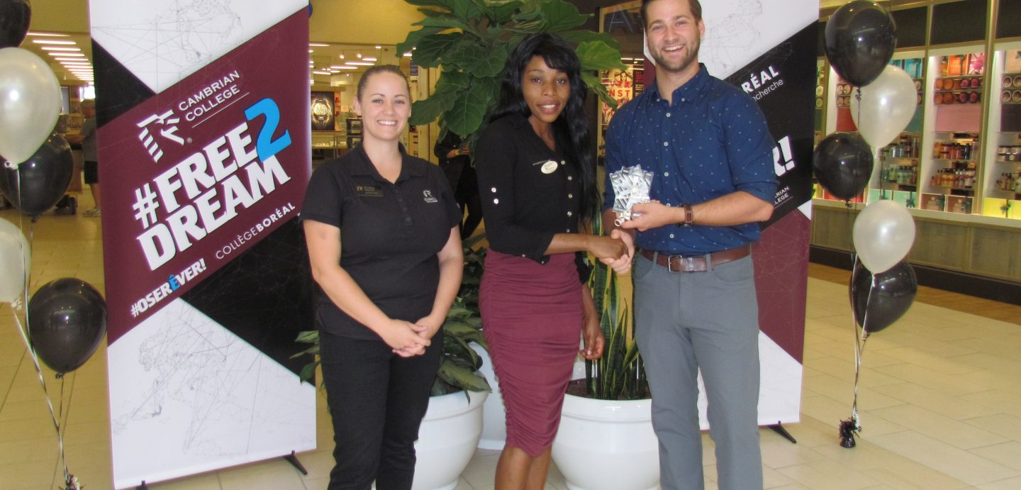 Pictured are: (L-R) Christine Taschuk, Cambrian College Recruitment Manager; prize winner Blessy Morvan, and Collège Boréal Liaison Manager Jacob Sirois. Not pictured: prize winner Ines Bagaoui.
